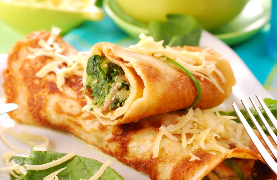 Rolled pancakes stuffed with the spinach